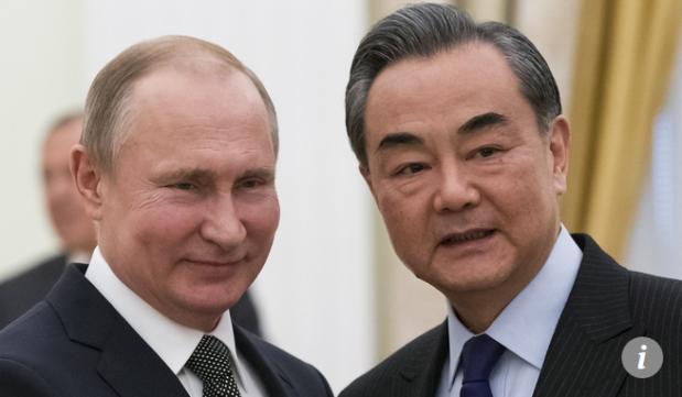 Capture Vladimir Poutine et Wang Yi